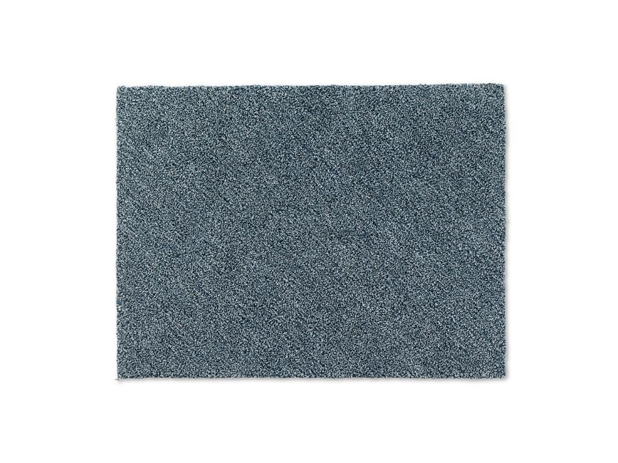 Handtuftad matta Leo i blå färgställning.